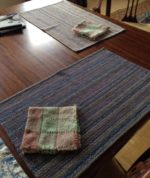 My dining room table. The place mats were a gift, and made by a weaver in Virginia. The napkins were made by Sharon Alderman as a Handwoven contributor's gift.