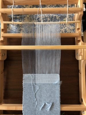 Loom Waste on the Back Apron Rod of a Flip Loom