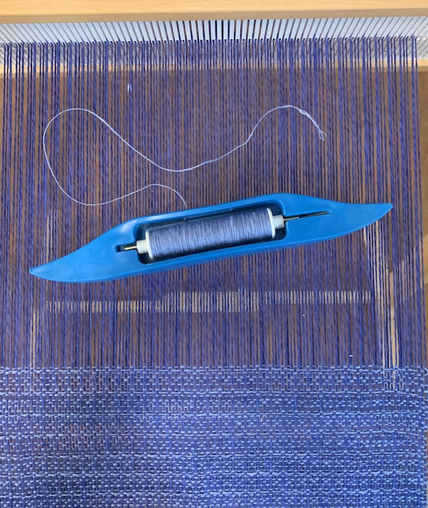 Gist's Duet doubled in a 12-dent rigid-heddle woven in windowpane.