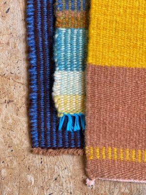 a trio of mini rugs